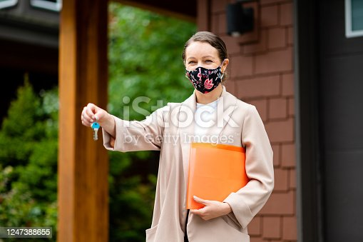Realtor wearing a face mask for COVID-19 safety. Reopening the economy after lockdown. Flattening the curve.