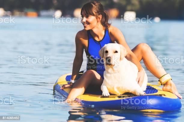 Realxing with dog on paddleboard picture id814065452?b=1&k=6&m=814065452&s=612x612&h= zw9quikjuldauzduzn6xq8bcgkuh92kjjjzpodskqu=