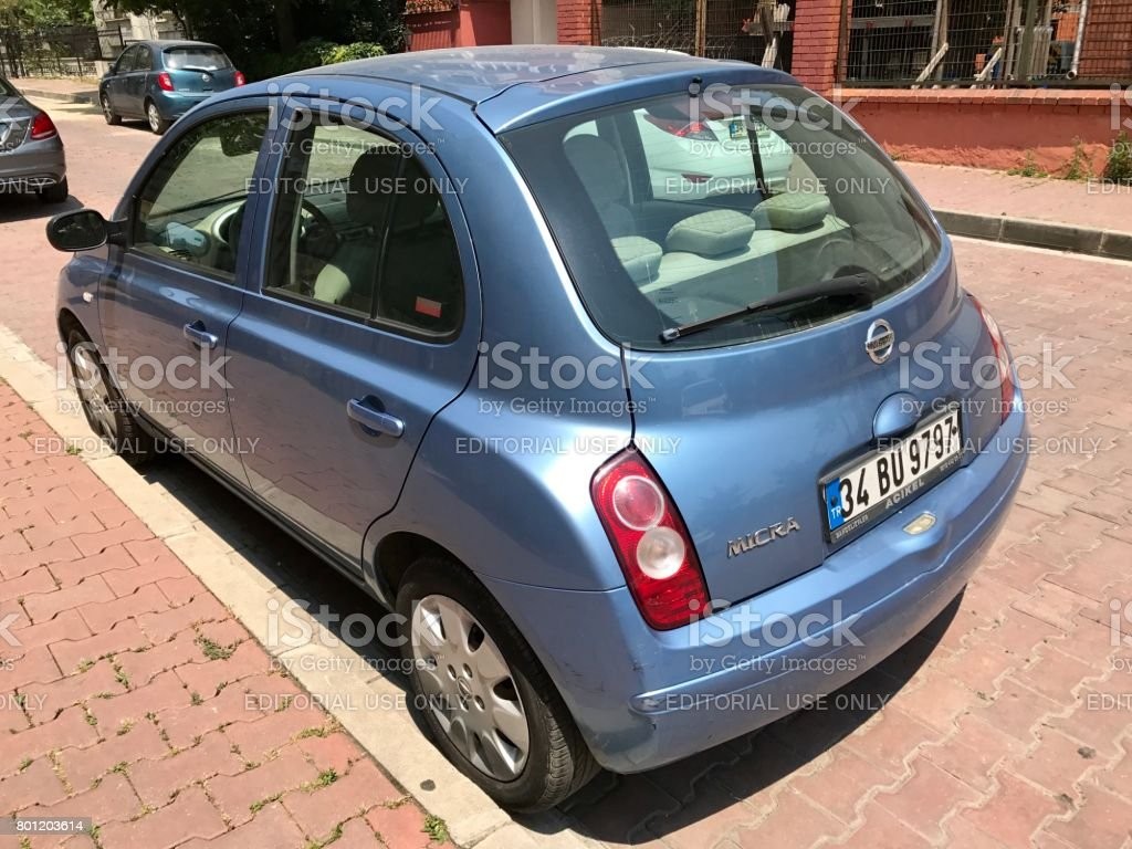 Rear and side view of a  Nissan Micra stock photo