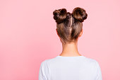 istock Rear back behind view of nice attractive groomed girl wearing two fashionable buns isolated over pink pastel background 1127540474