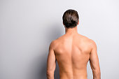 istock Rear back behind view photo of strong muscular handsome attractive stunning confident ideal perfect sportsman isolated on gray background copyspace 982845208