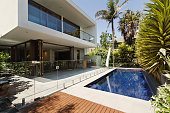 Rear garden of a contemporary Australian home with tiled swimming pool