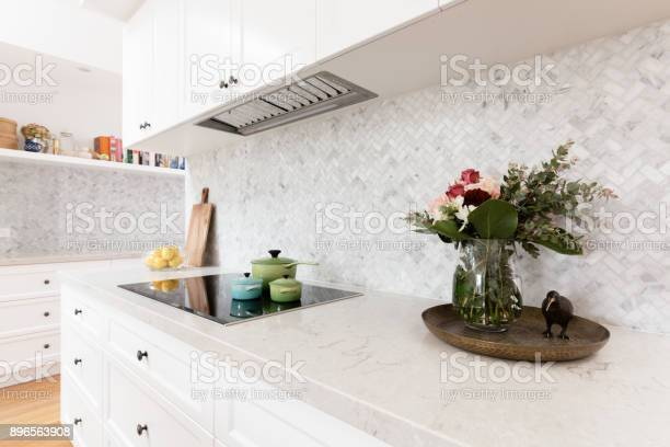 Rear kitchen bench styled with cut flowers and colorful saucepans picture id896563908?b=1&k=6&m=896563908&s=612x612&h=zpqbbjxqawfzxsgi75amek1 n0u kedvpywcaa2qogq=