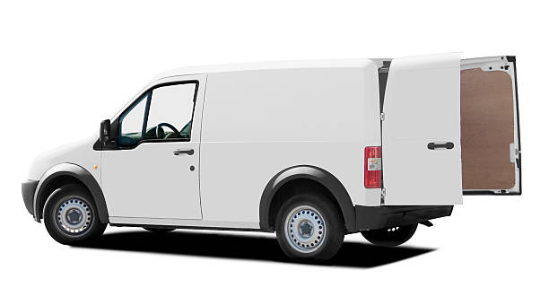 Rear of white van with doors open on white stock photo