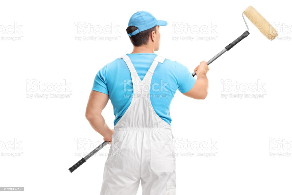 Rear shot of a painter with a paint roller stock photo
