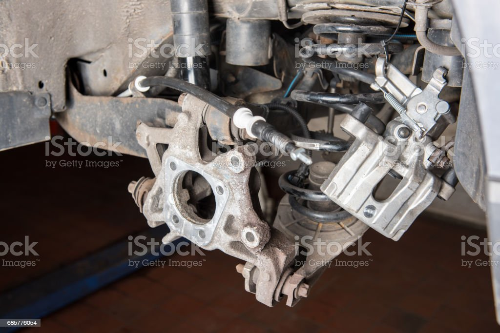 rear suspension of an old car at the repair stock photo