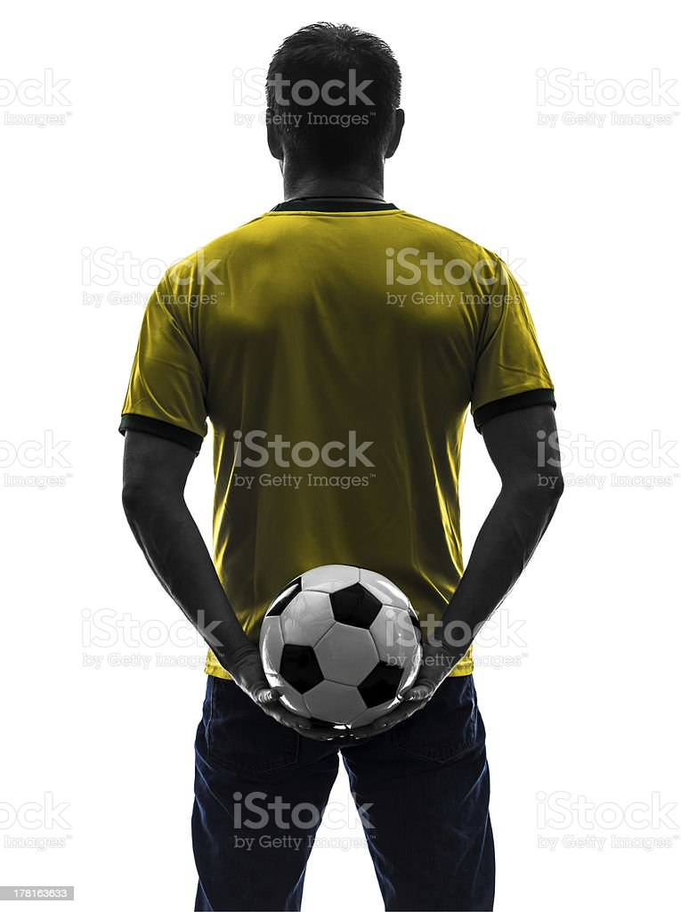 rear view back man holding soccer football silhouette royalty-free stock photo