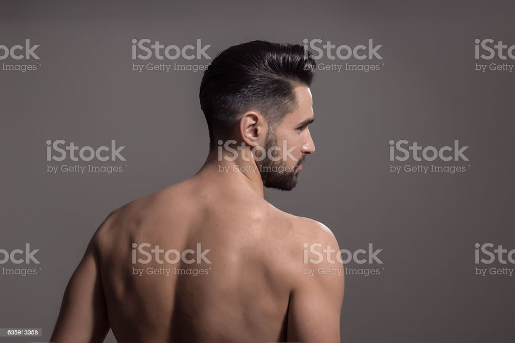 Rear view, back man muscles stock photo