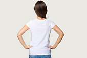 istock Rear view female wearing white t-shirt hold hands on waist 1151796091