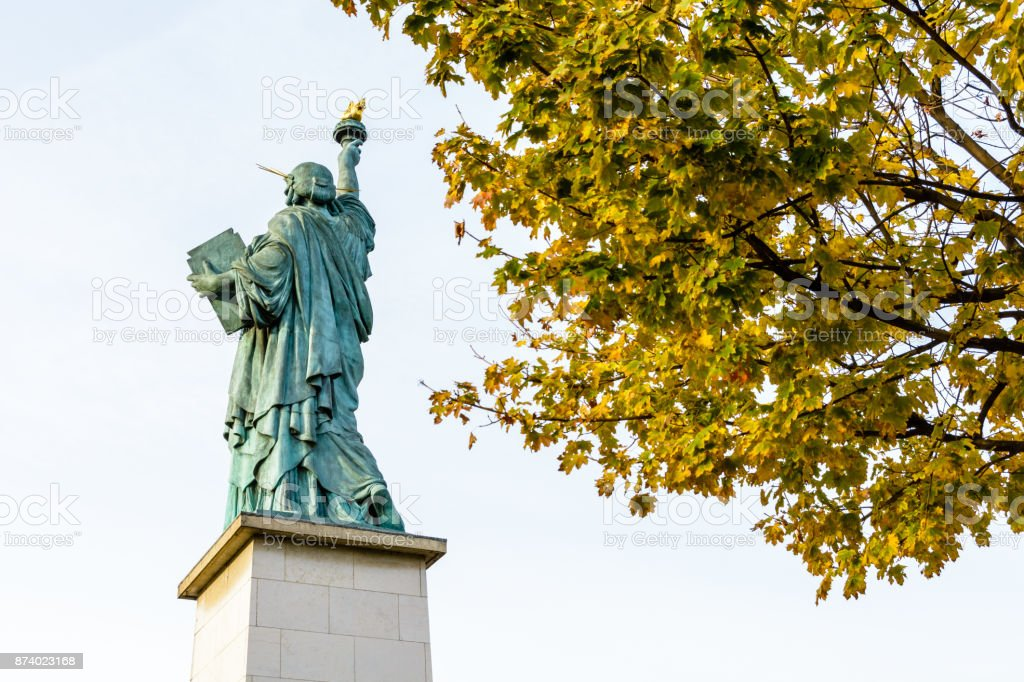 Rear view from below of the replica of the Statue of Liberty in Paris with yellow leaves in the foreground stock photo