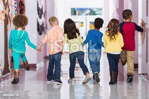 istock Rear view, group of preschoolers walking down hallway 485396718