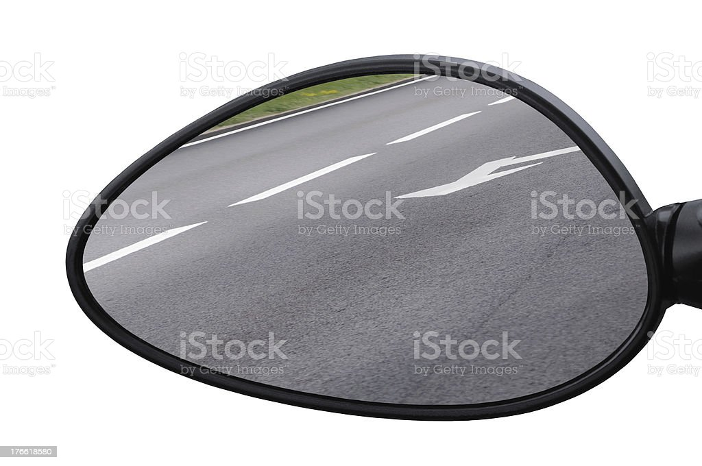 Rear view mirror reflecting road, left side lateral, macro closeup stock photo