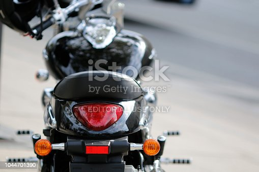 Hamburg, Germany - September 16. 2018: Rear view of a black new modern motorcycle, parked at a street in Hamburg, Germany