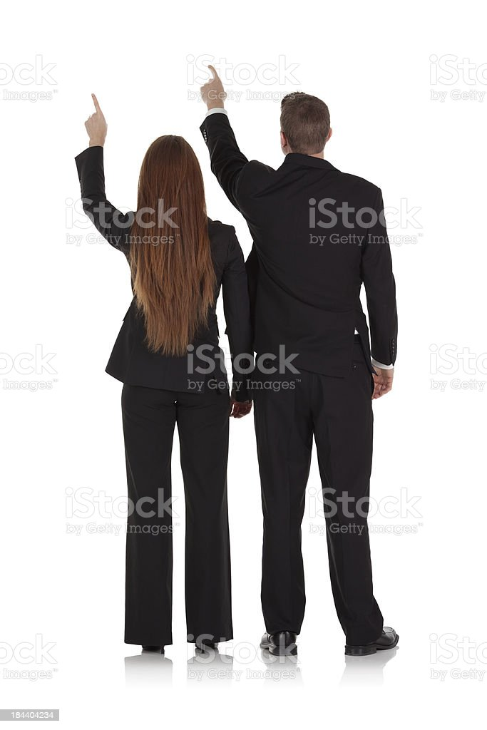 Rear view of a business couple pointing royalty-free stock photo