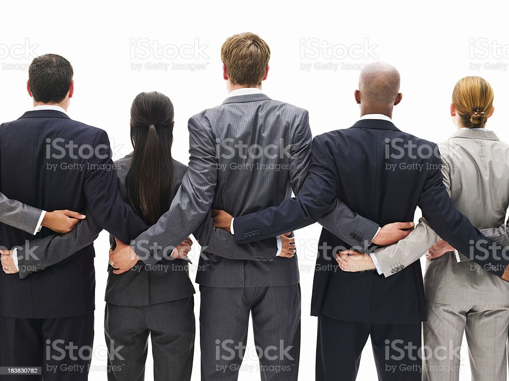 Rear View of a Business Team Standing Together stock photo