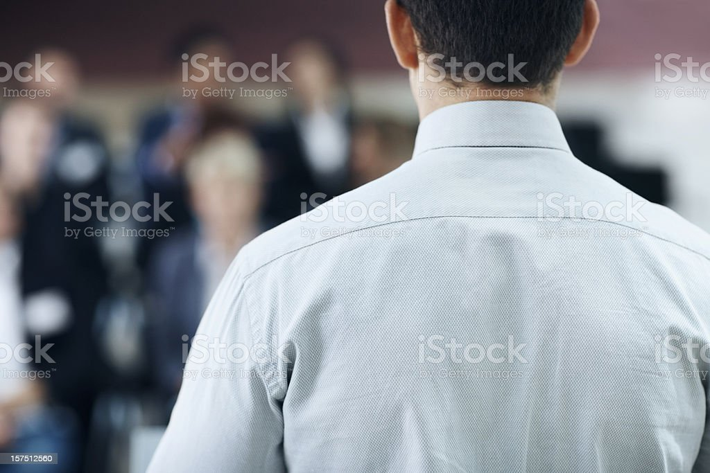 Rear view of a businessman giving presentation