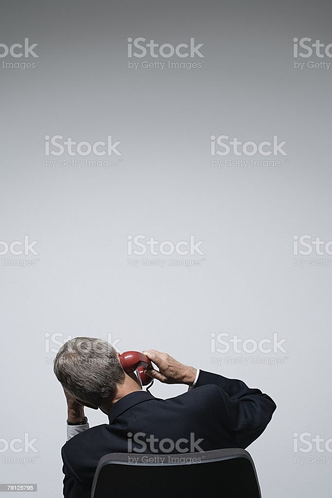 Rear view of a businessman on a phone 免版稅 stock photo