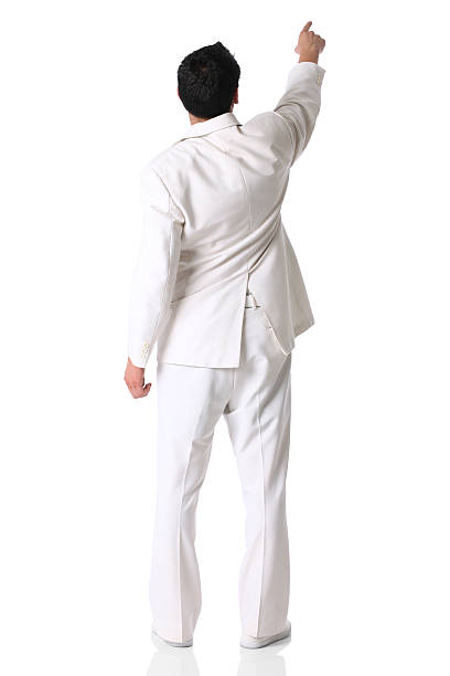 rear view of a businessman pointing with finger - white suit stock photos and pictures