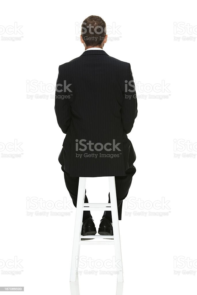 Rear view of a businessman sitting royalty-free stock photo