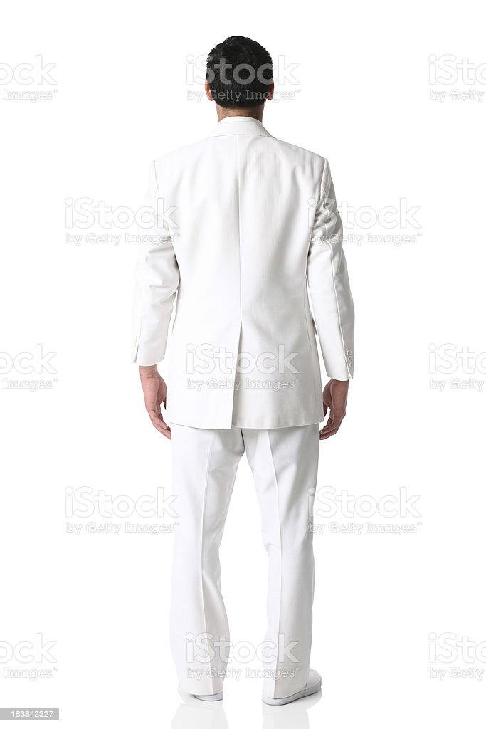 Rear view of a businessman standing in white suit stock photo