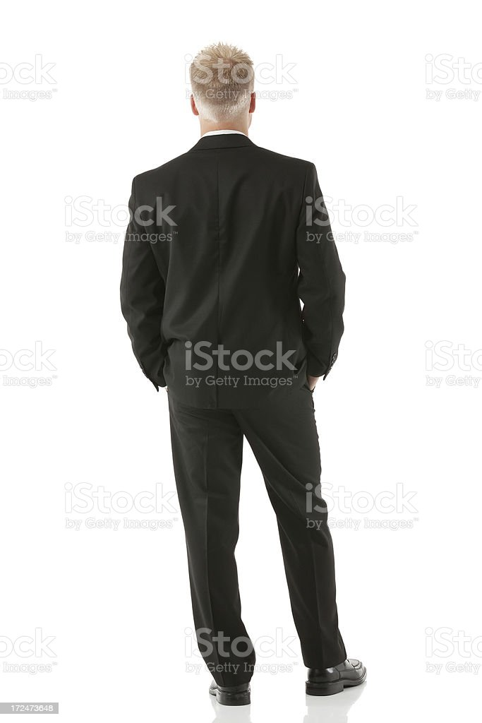Rear view of a businessman standing royalty-free stock photo