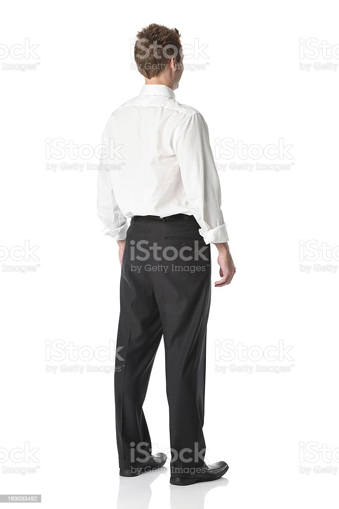 Rear view of a businessman standing stock photo