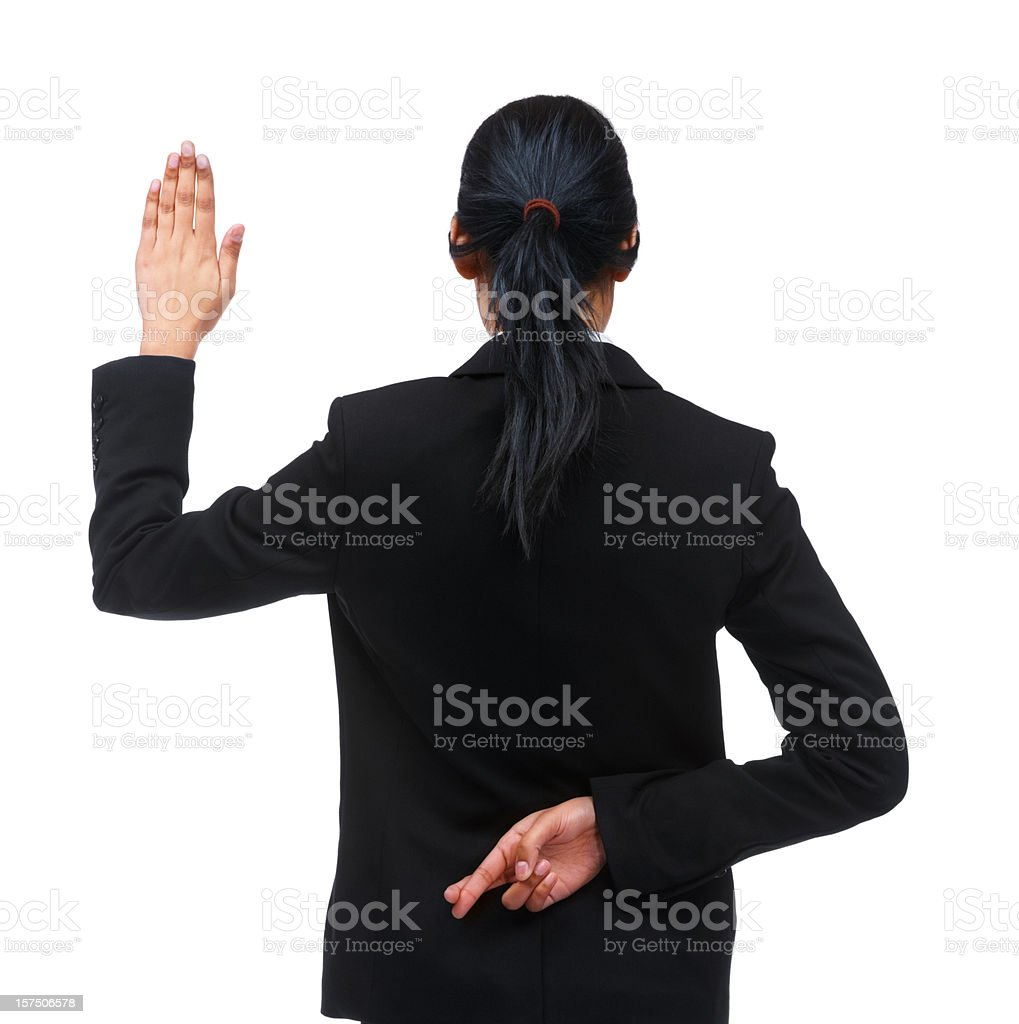 Rear view of a businesswoman crossing fingers royalty-free stock photo