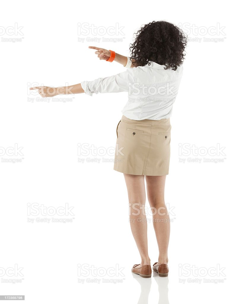 Rear view of a businesswoman pointing with finger royalty-free stock photo