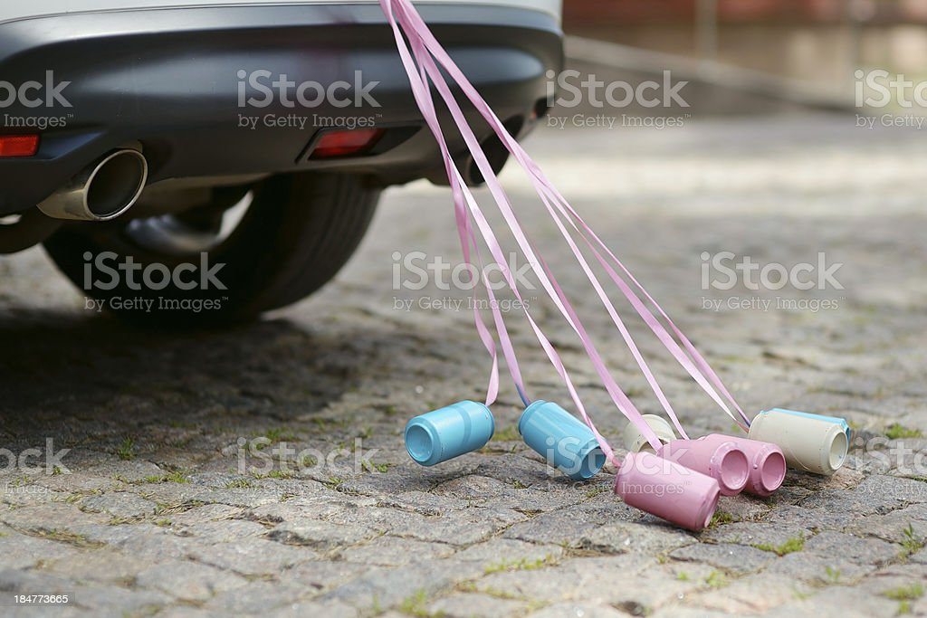 Rear view of a car with cans attached stock photo