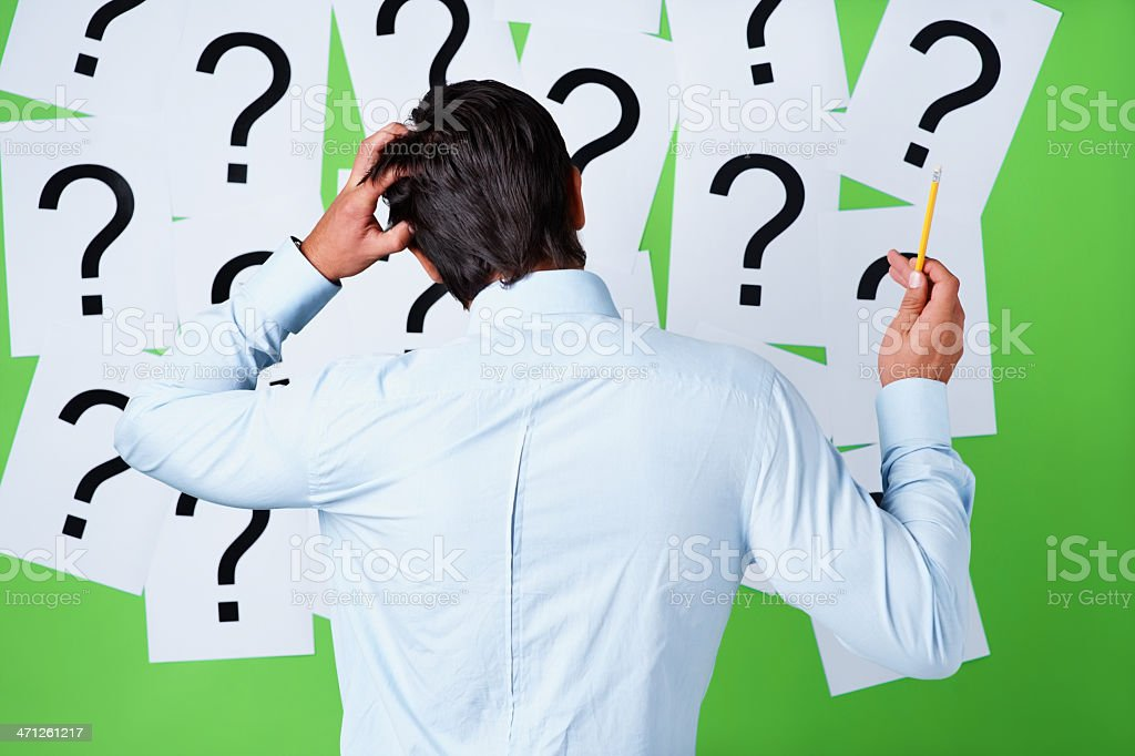 Rear view of a confused man scratching his head royalty-free stock photo