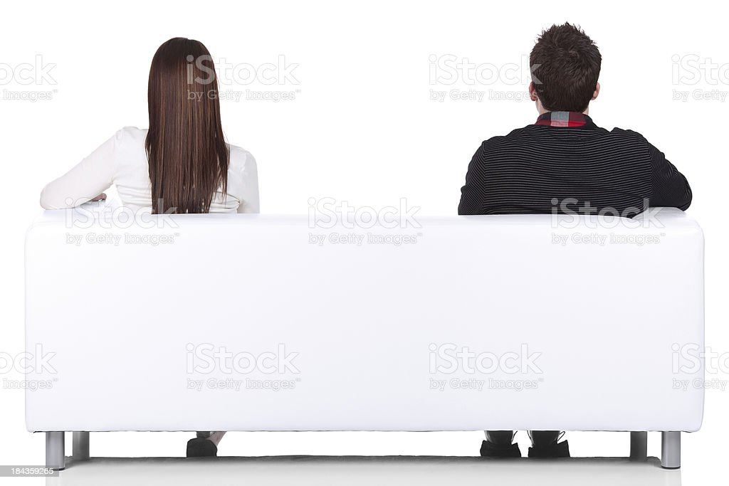 Rear view of a couple sitting on couch stock photo