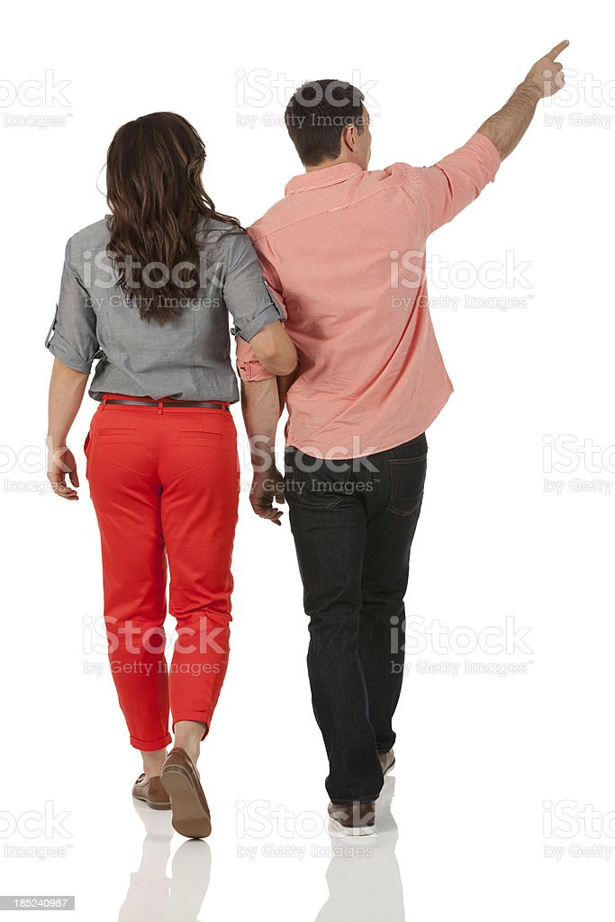 Rear view of a couple walking stock photo