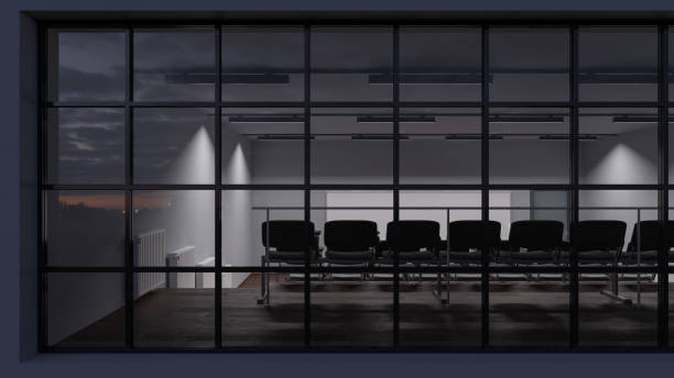 rear view of a dimly illuminated lecture hall behind the windows - dimly stock pictures, royalty-free photos & images