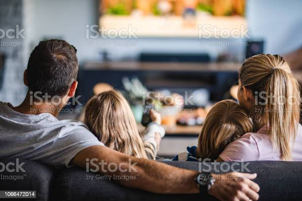 Rear view of a family watching tv on sofa at home picture id1066472014?b=1&k=6&m=1066472014&s=612x612&h=czbriao9y3cutz8kqlyu6rio826dvs67vkbgr xorme=