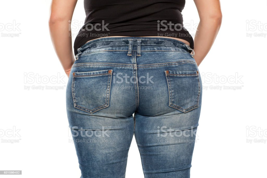 rear view of a fat woman in jeans on white background stock photo