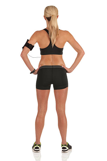 Rear view of a female athlete Rear view of a female athlete akimbo stock pictures, royalty-free photos & images