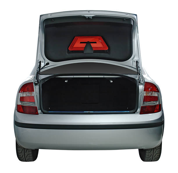 Rear view of a generic car with an open trunk stock photo