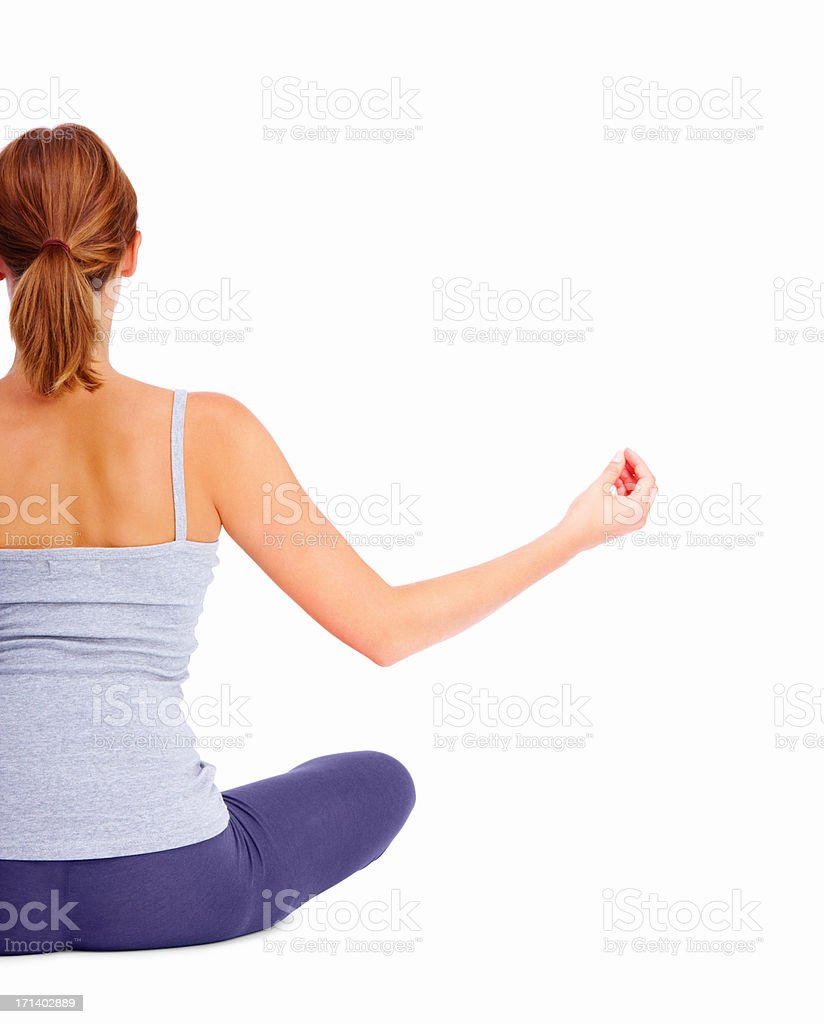 Rear view of a girl sitting, isolated on white background stock photo