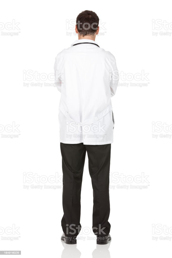 Rear view of a male doctor standing with arms crossed royalty-free stock photo