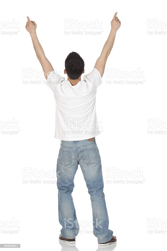 Rear view of a man cheering royalty-free stock photo