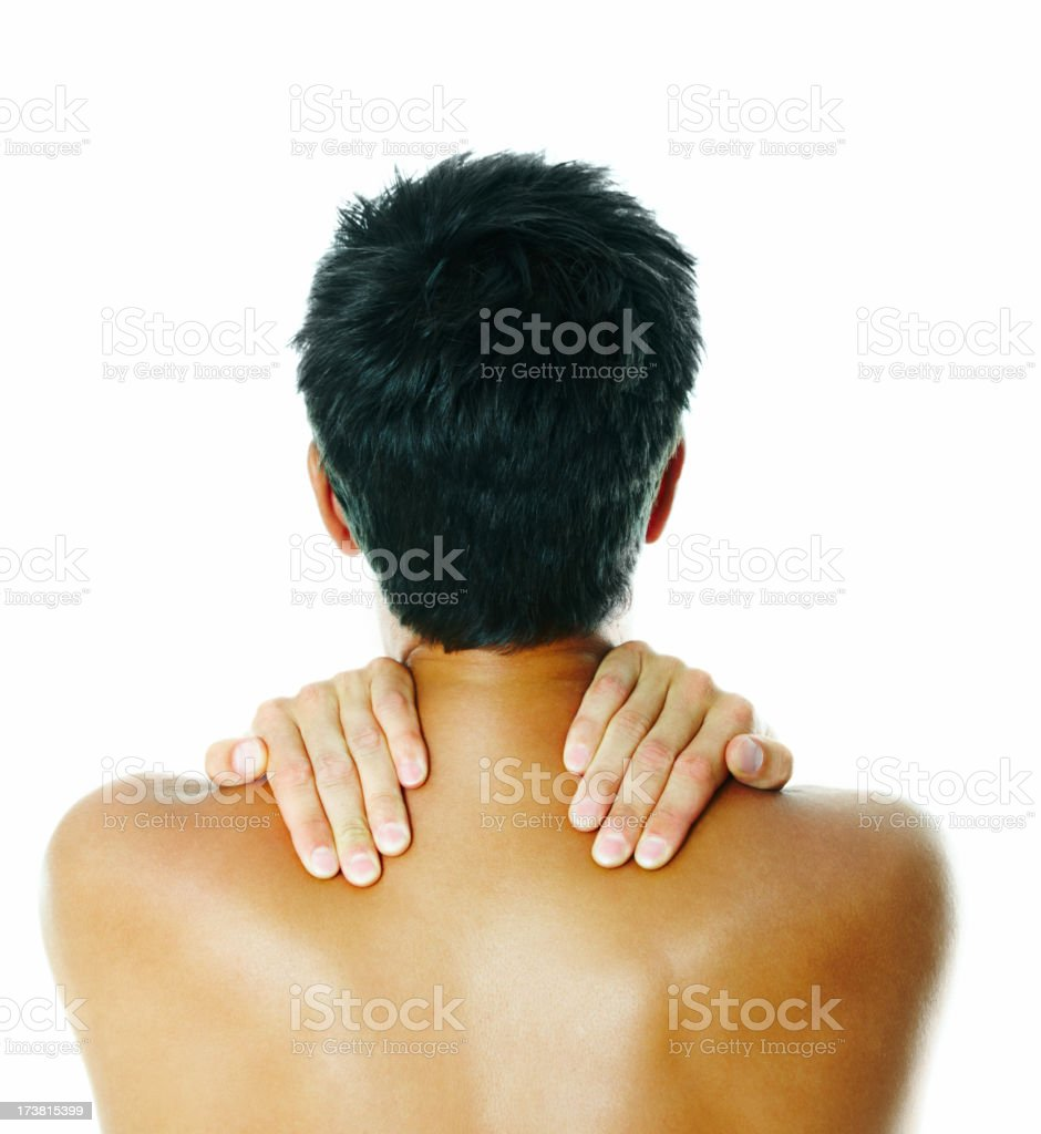 Rear view of a man holding his shoulders royalty-free stock photo