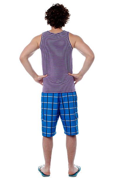 Rear view of a man in beach wear stock photo