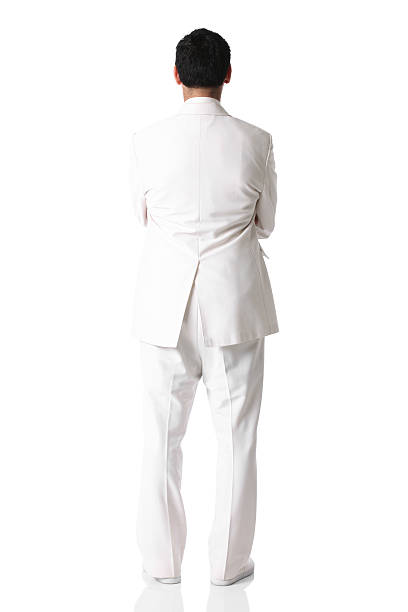 rear view of a man in white suit standing with arms - white suit stock photos and pictures