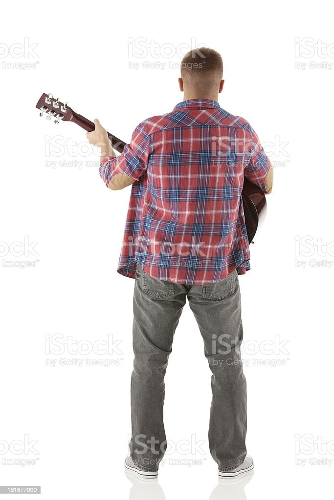 Rear view of a man playing guitar royalty-free stock photo