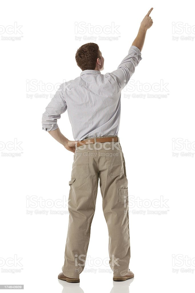 Rear view of a man pointing upward royalty-free stock photo