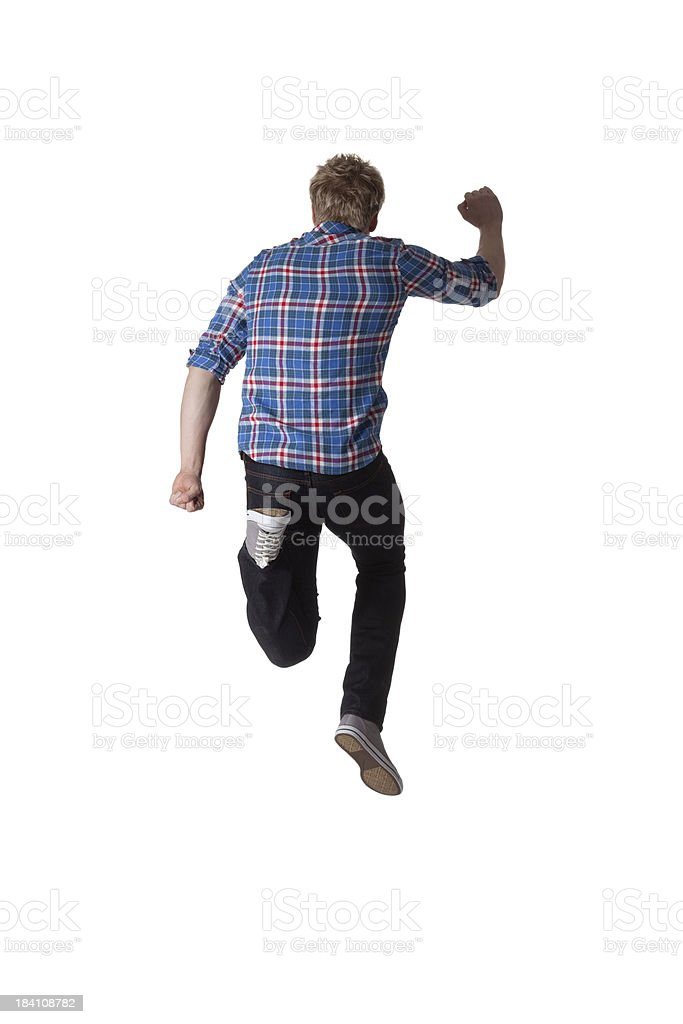 Rear view of a man running stock photo