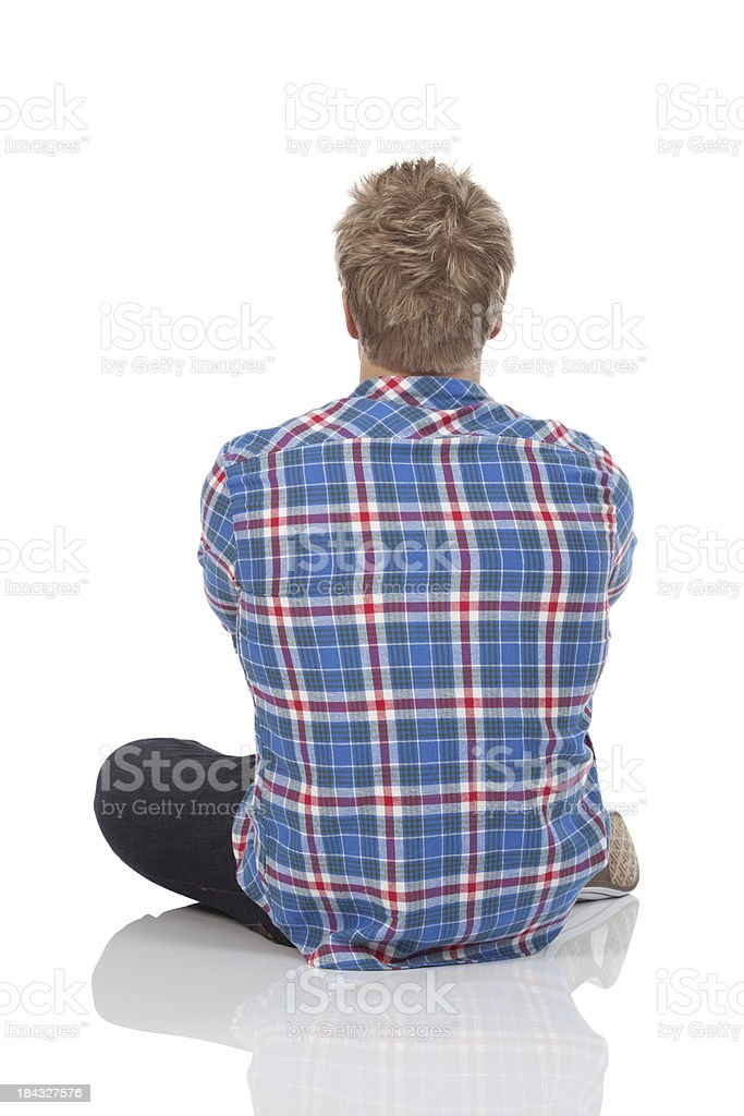 Rear view of a man siting on the floor royalty-free stock photo