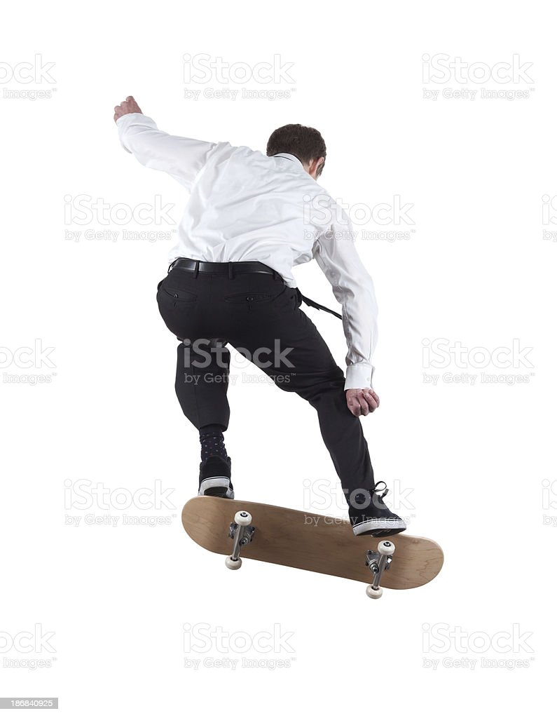 Rear view of a man skateboarding royalty-free stock photo