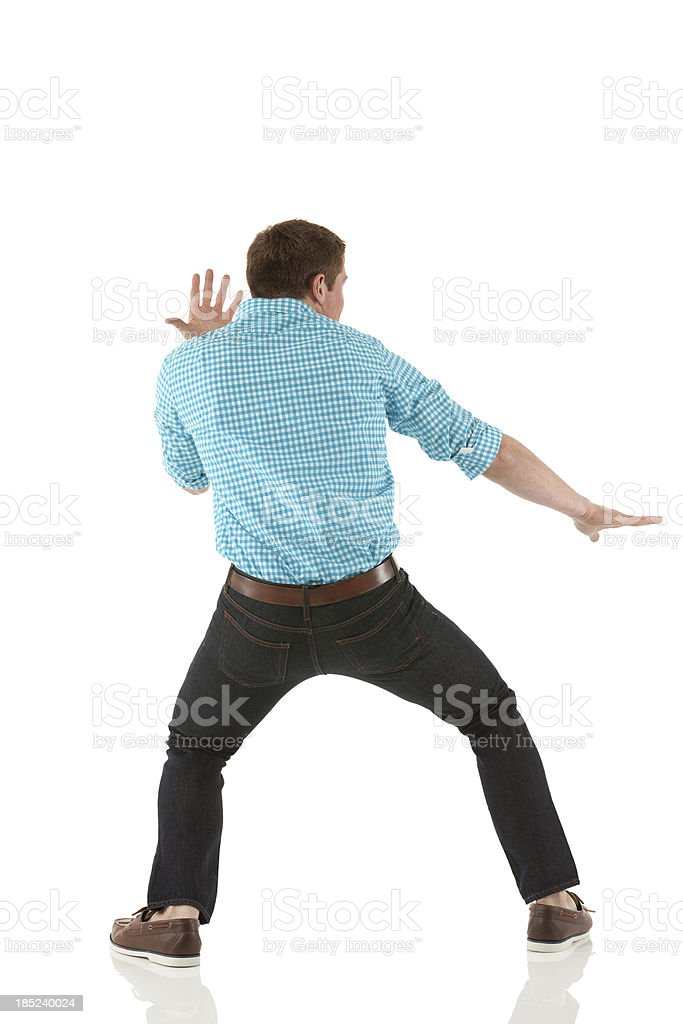 Rear view of a man standing in fighting pose stock photo