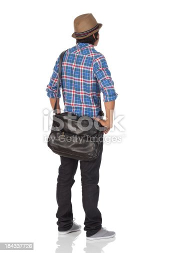 Rear view of a man standinghttp://www.twodozendesign.info/i/1.png